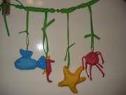 Spielkette für's Babybettchen
