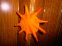 Filzen einer kleinen Sonne