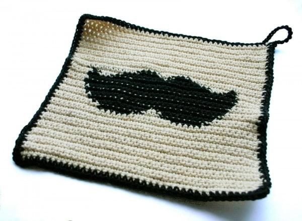 Moustache-Mania: Topflappen mit Bart. Oder Bartlappen.