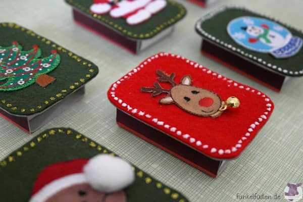 Weihnachtliche Streichholzschachteln