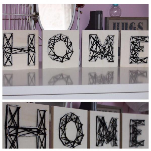 Buchstaben aus Wolle auf Holz