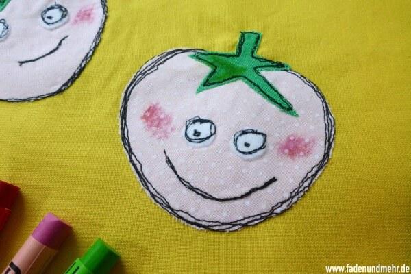 Erdbeer-Gesichter: Malen mit der Nähmaschine