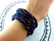 Spiralarmband aus Textilgarn