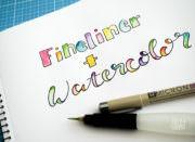 Handlettering mit Fineliner und Wasserfarbe malen