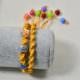 Wie kann man ein Geflochtes Armband mit Acrylperlen fertigen